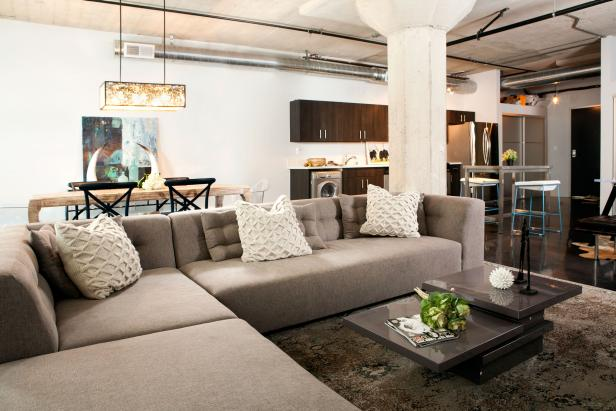 Industrial Modern Loft Living Room With Gray Sectional & White Pillows