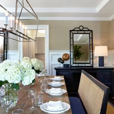 Neutral Transitional Dining Room With Wainscoting