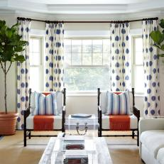 Transitional Neutral Living Room With Polka Dot Curtains