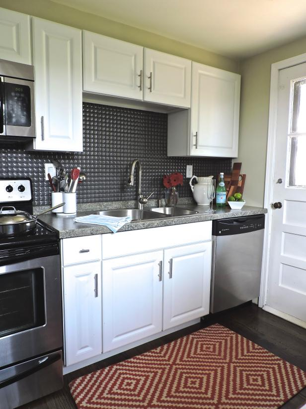 small kitchen with black quilt like backsplash