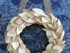This paper leaf wreath is a modern take on the magnolia or herb wreaths you often see around the holidays. Best of all, the neutral color scheme means you can display it indoors all winter long.