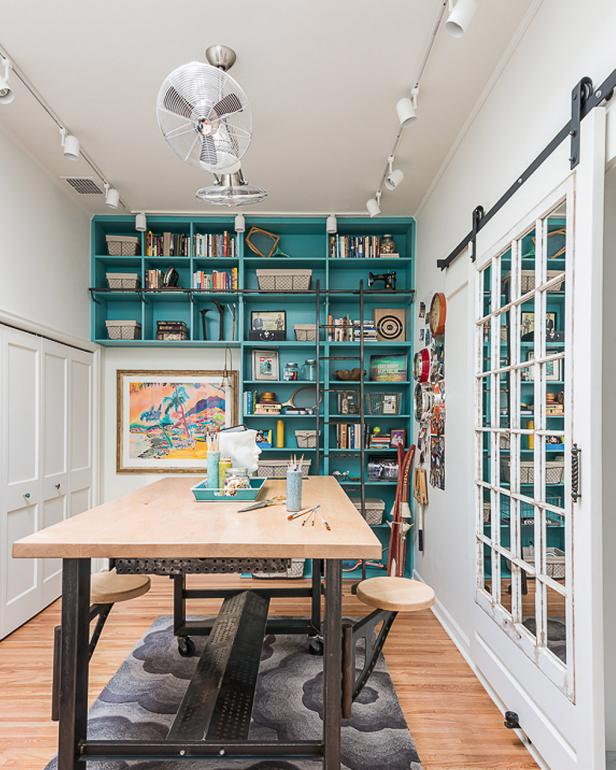 White Crafts Room With Turquoise Built-In Bookshelf