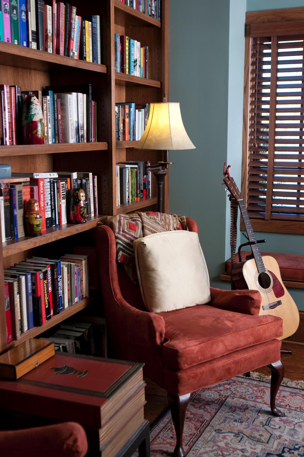 Blue library with red armchair and wooden blinds hgtv for Mountain house library