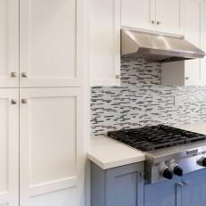 Blue and White Kitchen Cabinets and Mosaic Tile Backsplash