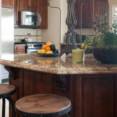 Traditional Kitchen Island With Barstools and Granite Countertop
