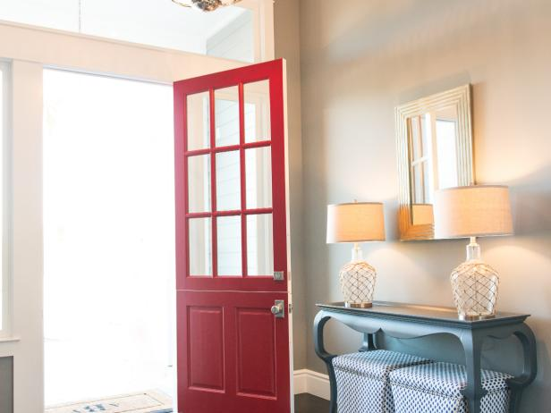 Entryway With Red Front Door and Moroccan Print Rug