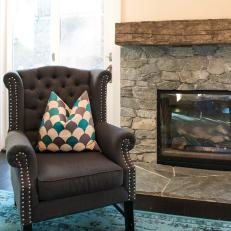 Tufted Brown Wingback Chair By Stone Fireplace : blue leather wingback chair - Cheerinfomania.Com