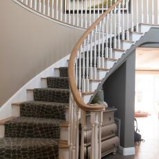 Staircase With Brown Giraffe-Print Runner