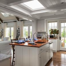 Brightly Lit White Kitchen With Skylight