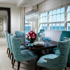 Tropical White Dining Area With Aqua Patterned Chairs