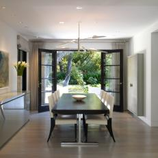 French Doors Open Modern Dining Room to Backyard