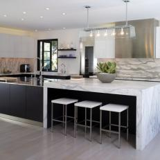 Modern Black and White Kitchen With Marble Countertops