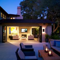 Large Doors Open the Living Room to a Patio Lounge Area