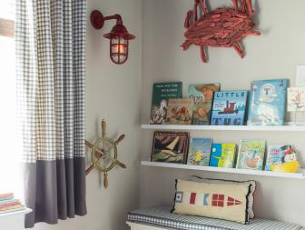 Kid's Nautical Bedroom With Bookshelves and Storage Bench