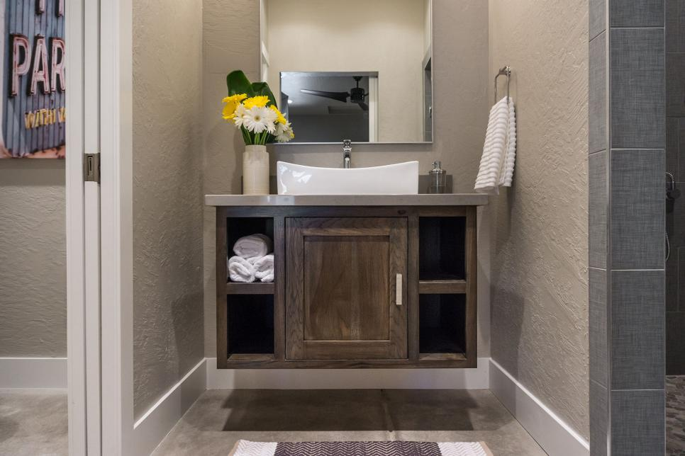 Rustic Floating Vanity With Cubby Holes in Small Bathroom