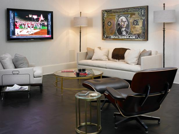 White Living Room With Money Artwork, Cream Sofa and Eames Chair