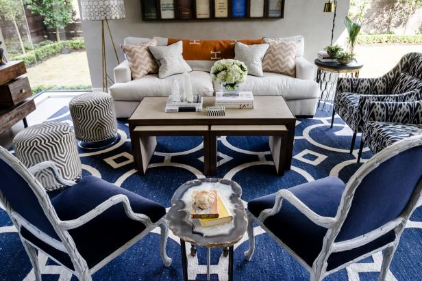 Seating Area With Neutral Sofa, Nesting Coffee Table and Navy Chairs
