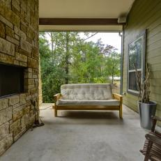 Country Deck With Stone Fireplace and Outdoor Sofa