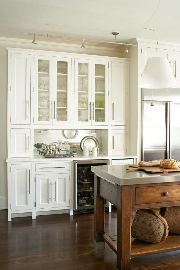 White Kitchen With Brown Wood Island and White Cabinets