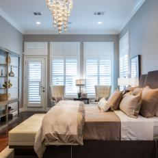 Transitional Neutral Bedroom With Dazzling Chandelier