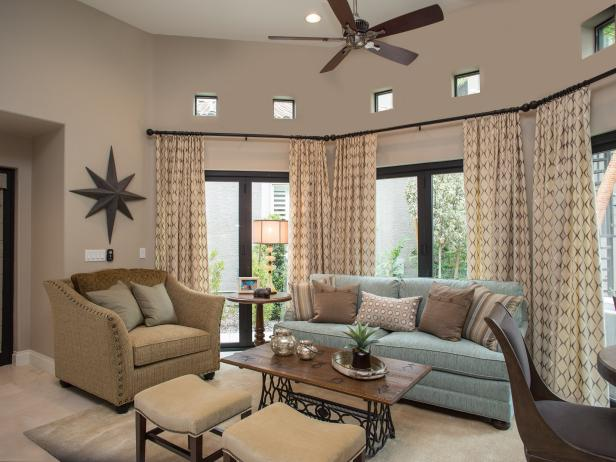 Open Neutral Living Room With Blue and Brown Accents