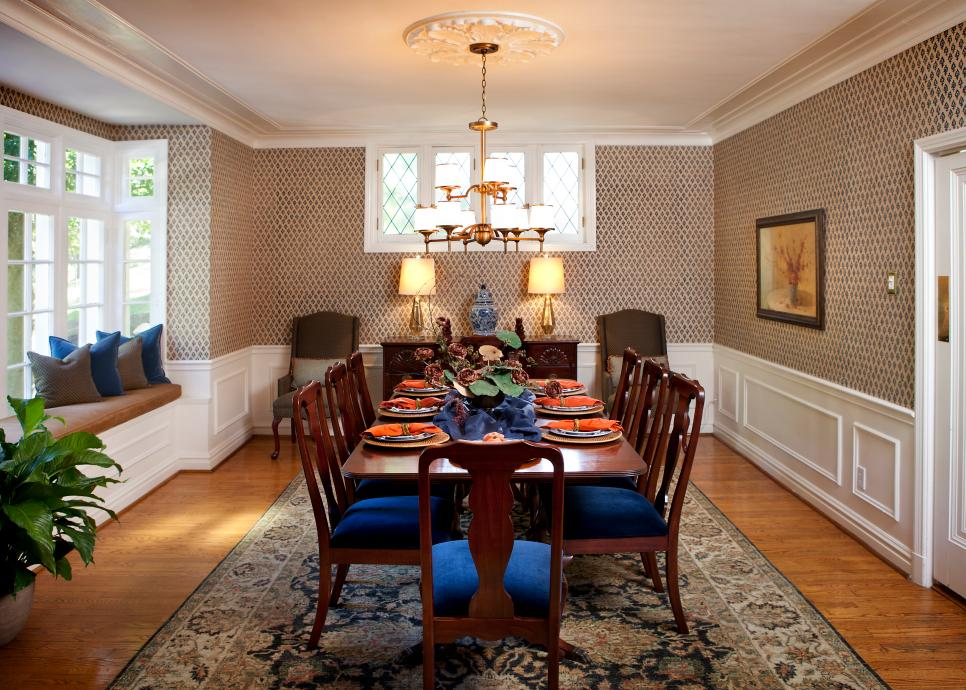 Traditional Dining Room With Brown Patterned Wallpaper and Window Seat