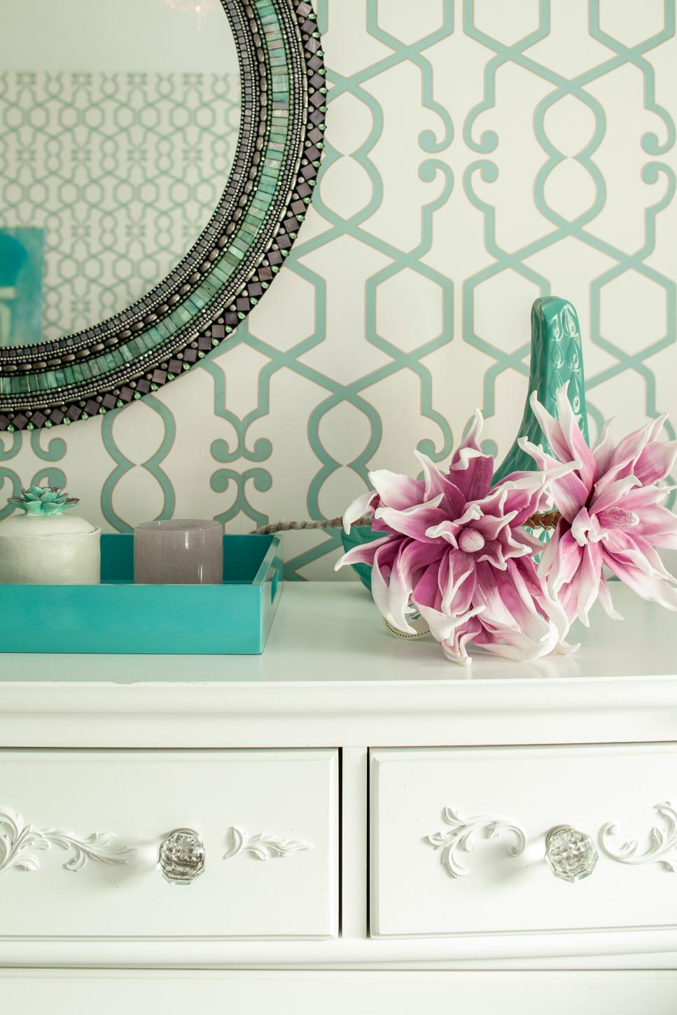 White Dresser Against White and Turquoise Patterned Wall