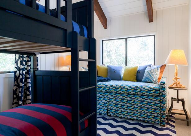 Transitional Bedroom With Black Bunk Bed and Patterned Sofa