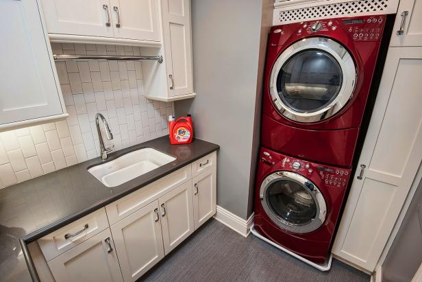 Gray And White Laundry Room With Red Washer and Dryer