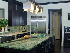 Contemporary Kitchen With Green Island Countertop