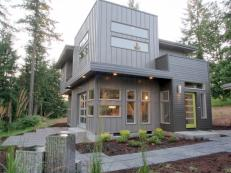 Exterior View of Modern Gray Home With Stone Tile Walkway