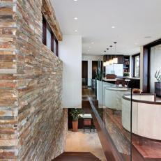 Stacked Stone Warms Up Contemporary Stairway