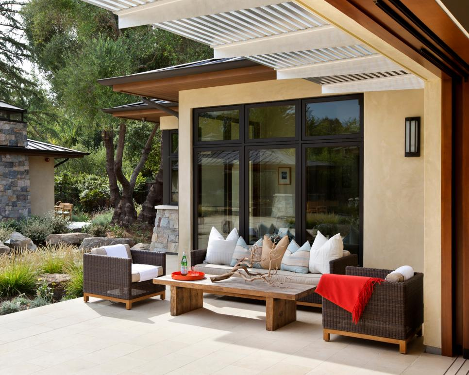 Contemporary Back Patio With Brown Outdoor Furniture