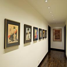Off-White Hallway Lined With Asian Artwork