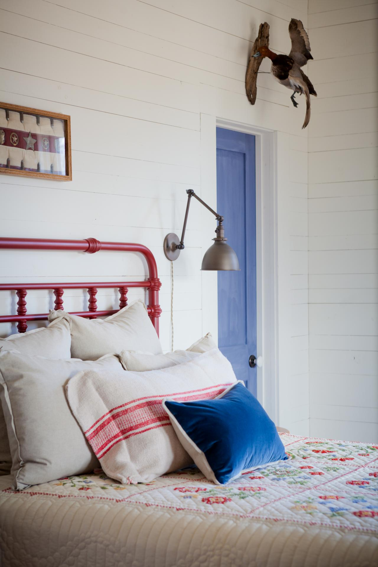 Fashion Inspired Guest Room: White Country-Style Bedroom With Red Iron Headboard