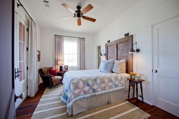 White Farmhouse Bedroom With Wood Shutter Headboard