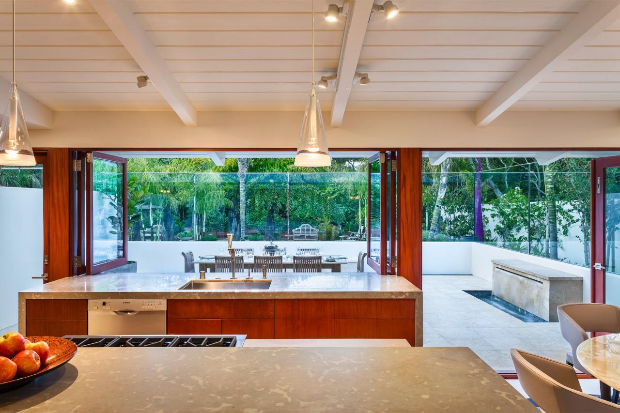 Modern Kitchen With Limestone Countertopahogany Cabinetry