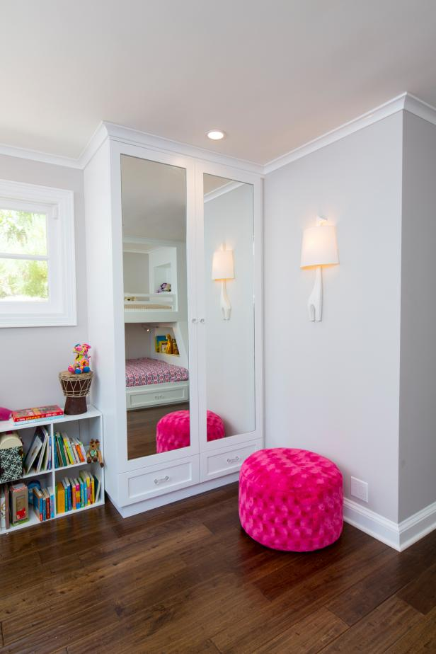 Mirrored Closet Doors With Recessed Lighting and Pink Ottoman