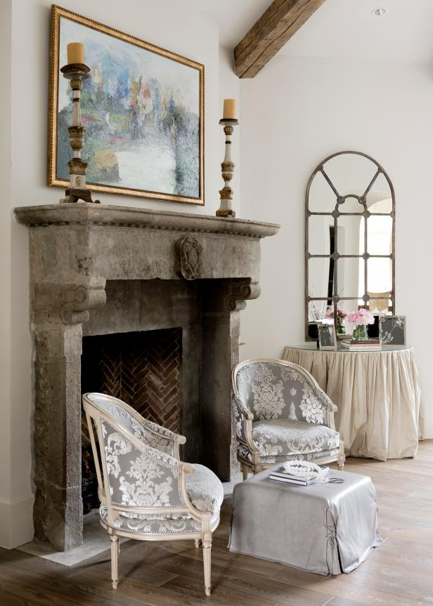 Silver Damask Armchairs by Concrete Fireplace in White Living Room