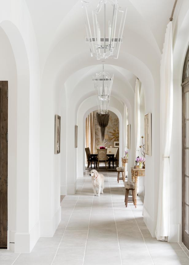 White Hall With Tall Ceilings and Light Tile Floors
