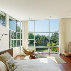Bright, Modern Bedroom Features Floor-to-Ceiling Windows