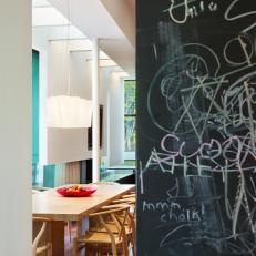 Contemporary, Family-Friendly Dining Area With Chalkboard Wall