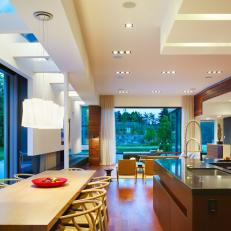 Modern Eat-In Kitchen With Horizontal Wood Paneling