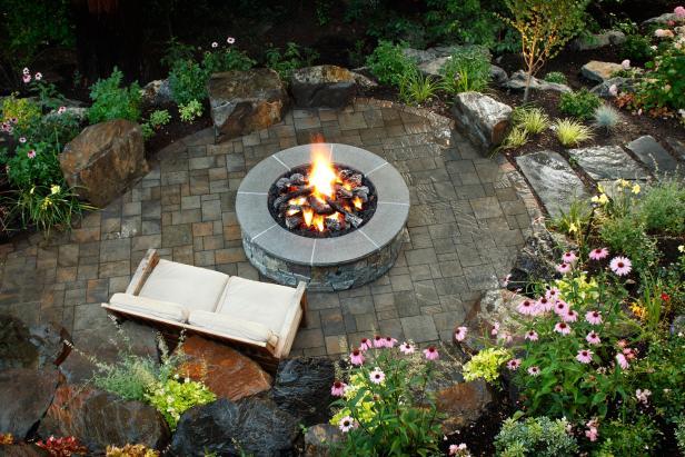 Backyard Patio With Gray Stone Fire Pit | HGTV