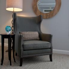 Master Suite Sitting Area Features Upholstered Wingback Chair
