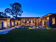 Modern Home Exterior and Courtyard at Night