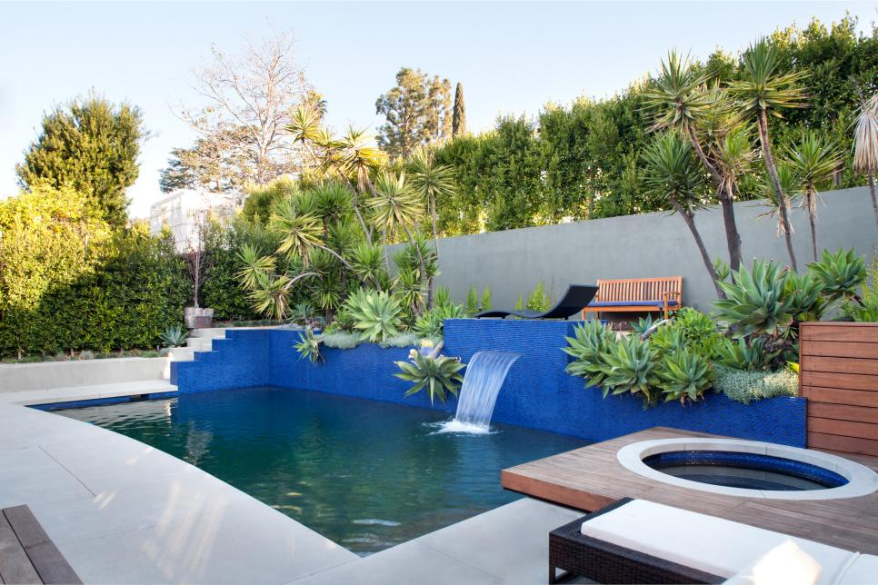 Contemporary Backyard Pool and Hot Tub With Landscaping
