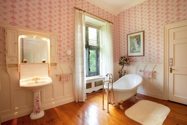 Pink and White Victorian Bathroom With Claw Foot Bathtub