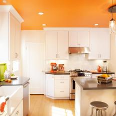 Contemporary Orange And White Kitchen With Eat In Island