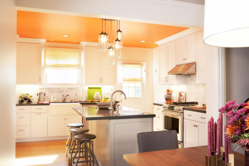 Transitional Kitchen in White With Orange Accents